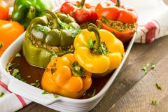 Stock Photo of Low calorie chipotle beef & bean stuffed chile peppers.