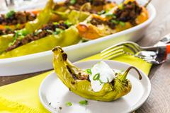 Low calorie chipotle beef & bean stuffed chile peppers. Stock Photos