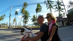 Couple on Motor Scooter with Dog. Slow Motion Stock Footage