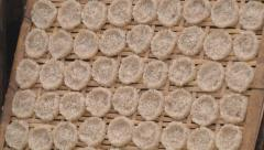 Rice cakes on the streets of Luang Prabang, Laos Stock Footage