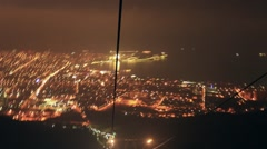 The descent on the cableway to the city at night. Stock Footage
