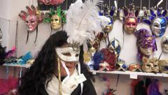 Beautiful girl tries mask for traditional Venice maskenbal. UHD 4K steadycam Stock Footage