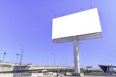 Blank billboard against blue sky for advertisement. Stock Photos