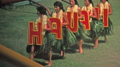 HAWAII 1976: Hawaii sign grass skirt hula dancers show off to crowds. Stock Footage