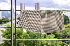 Shorts drying at condominium balcony in city. - stock photo