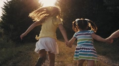 Kids are running cheerfully on the road Stock Footage