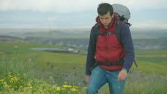 Young man in outdoor clothing with travel equipment hiking, tourism, recreation Stock Footage