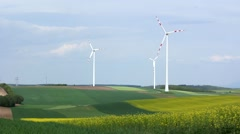 Windmills and yellow and green fields Stock Footage