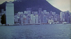 HONG KONG 1973: Skyline from the harbor shows off the architecture of the time. Stock Footage
