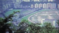 HONG KONG 1973: Polo field view from Victoria Peak Hong Kong harbor. Stock Footage
