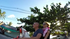 Happy Family on Scooter Enjoying Tropical Road Trip with Dog Stock Footage