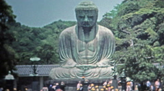 SINGAPORE 1973: Wise Siddhartha Gautama Buddha statue in Asia tourist visits. Stock Footage