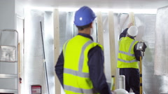 4k Portrait of smiling engineering or construction worker at building site - stock footage