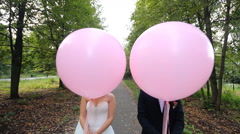 Happy bride and groom with balloon - stock footage