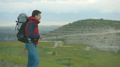 Guy taking off heavy rucksack, breathing fresh air, enjoying amazing landscape Stock Footage
