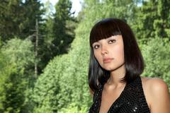 beautiful girl against the foliage shined - stock photo
