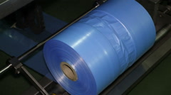 Plastic Bags on a Roll in The Production - stock footage