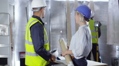 4k Portrait of smiling engineering or construction workers at building site - stock footage
