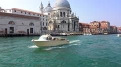 Yacht float at Venice Grand Canal near basilica Santa Maria della salute. uhd - stock footage