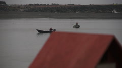 Fishing Action, red roof, Fishermen Fishing. Stock Footage