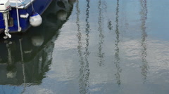 Reflections on the water in a harbor Stock Footage