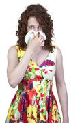 Stock Photo of Woman Blowing Her Nose