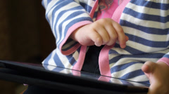 Little girl playing games on  computer tablet Stock Footage