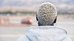 Backside of an african blond woman Stock Photos