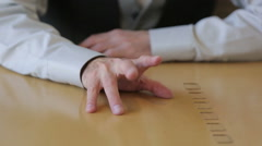closeup of male hands tapping impatient on a desk - stock footage