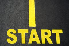 Start up Sign on Road Closeup Stock Photos