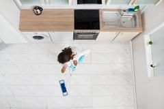High Angle View Of Woman Mopping Floor In Kitchen Stock Photos