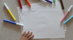 Small kid drawing a house. - stock footage