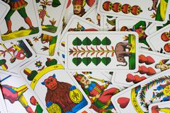 Scattered playing cards Stock Photos