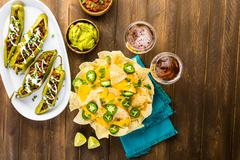Stock Photo of Vegetarian nachos with tortilla chips and fresh jalapeno peppers