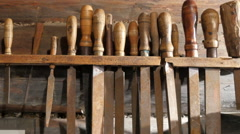 Different sizes of chisels hanging - stock footage