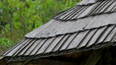 Black wooden shingles from the rooftop Stock Footage
