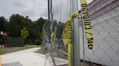 Caution tape on fence - stock footage