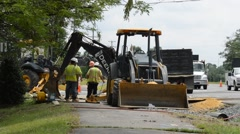 Digger and road crew Stock Footage