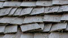 Wooden shingles on the wooden log house - stock footage