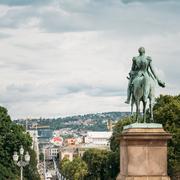Statue of Norwegian King and main street Karl Johans Gate leadin Stock Photos