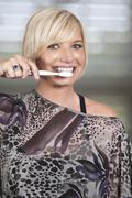 Beautiful Woman Brushing Teeth - stock photo