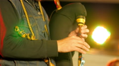 A man in custome playing a musical instrument Stock Footage