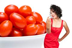 Black Woman and Cherry Tomatoes Stock Photos