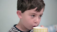 Drinking tea and chewing close up Stock Footage