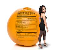 Black Woman with Orange Nutrition Facts Stock Photos