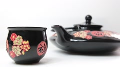 Still of oriental teapot and his cup with changing focus in different speed Stock Footage