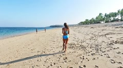 Girl running on the beach in Indonesia, Bali. Stock Footage