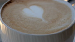 The heart shaped design on the coffee Stock Footage