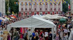 People flocking on the street in Tartu Stock Footage