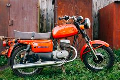 Vintage Red Motorcycle Generic Motorbike In Countryside - stock photo